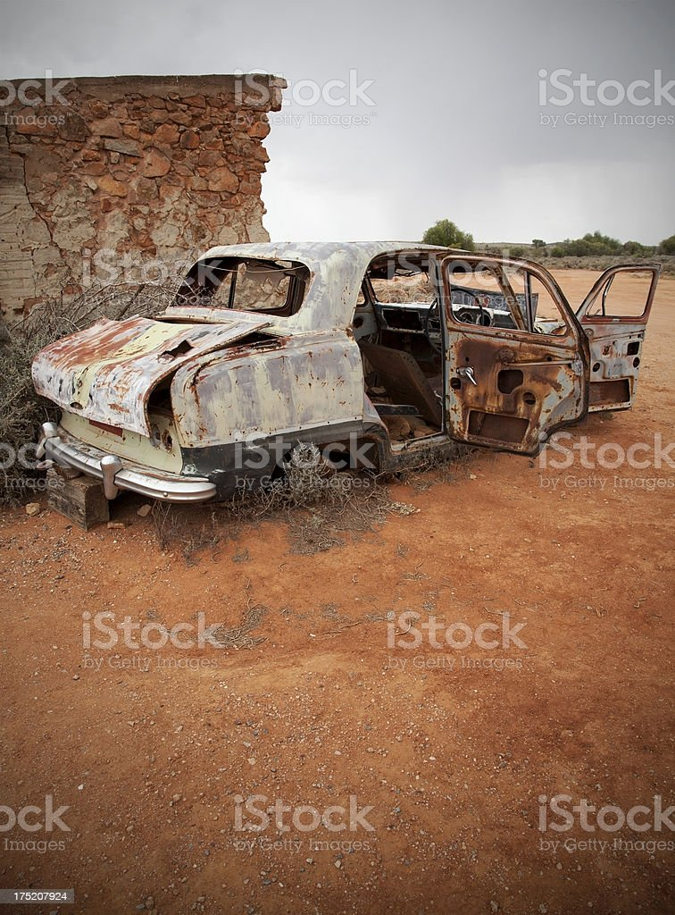 Ruined car and building at Silverton, Australia royalty-free stock photo