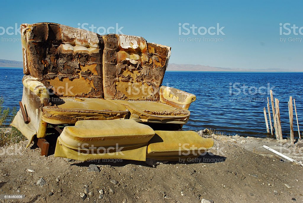 Ruined chair by Salton Sea stock photo