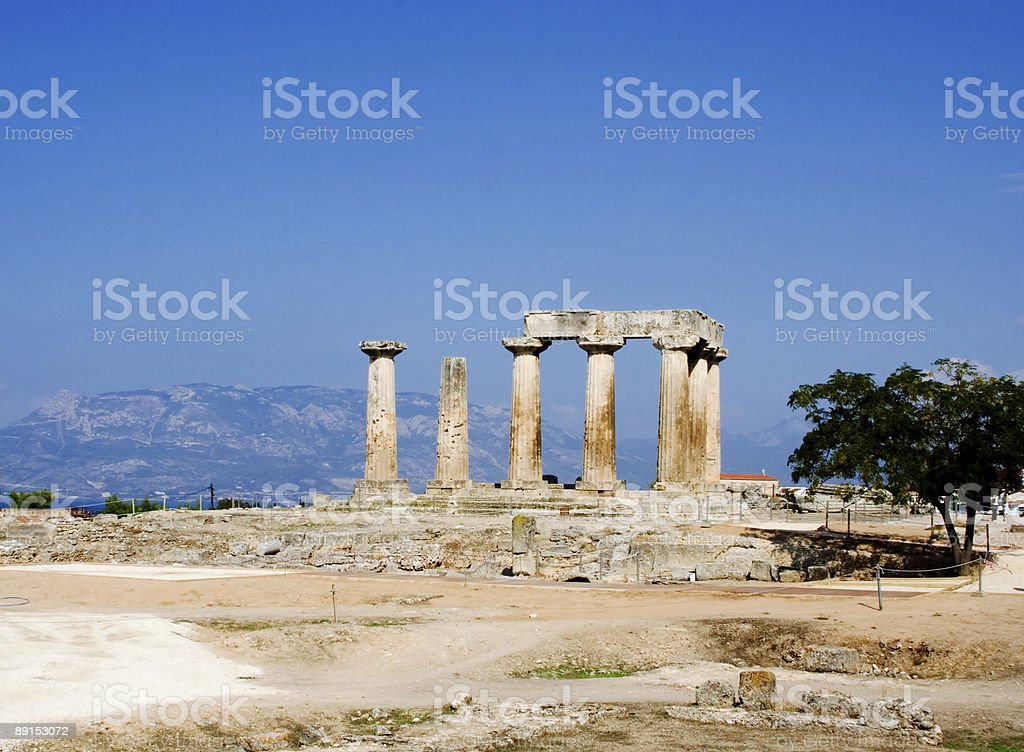 ruined columns of ancient temple in corinth greece royalty-free stock photo