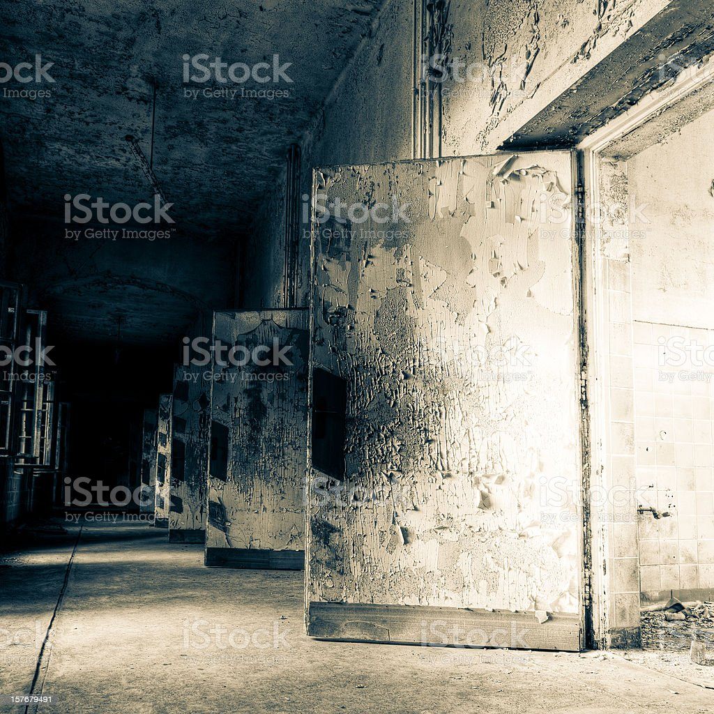 Ruined Hospital Corridor Architecture With Wooden Doors royalty-free stock photo