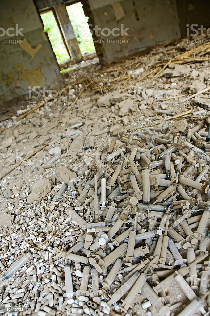 Ruined Place Full of Used Narcotic Syringes royalty-free stock photo