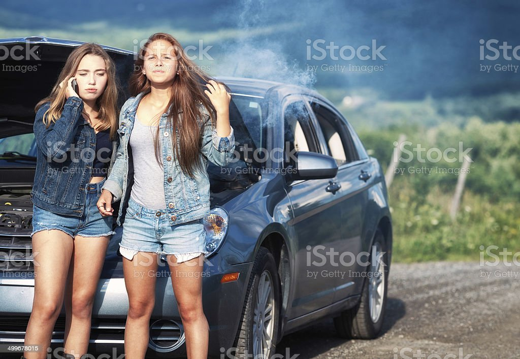 Ruined road trip: teenagers call for help stock photo