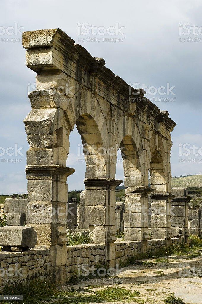 Ruined Stone Arches on Decimanus Maximus, Volubilis, Morocco stock photo