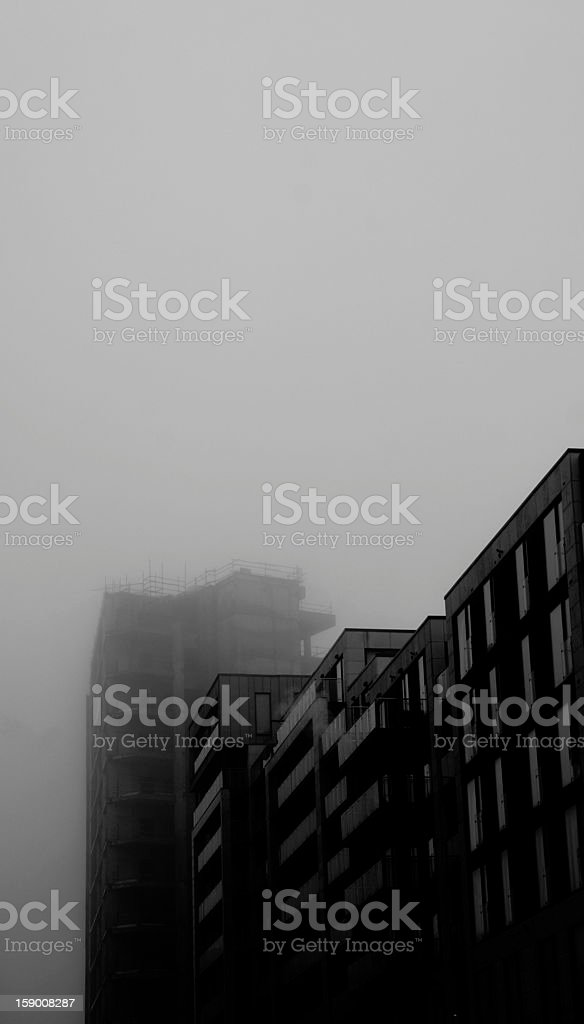Ruined tower block in the mist. (Black and White) royalty-free stock photo
