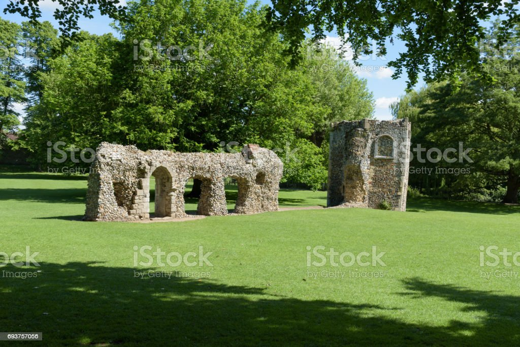 Ruined wall and dovecote of medieval abbey stock photo