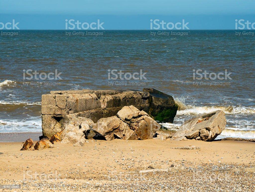 Ruined WW2 buildings on an English beach stock photo