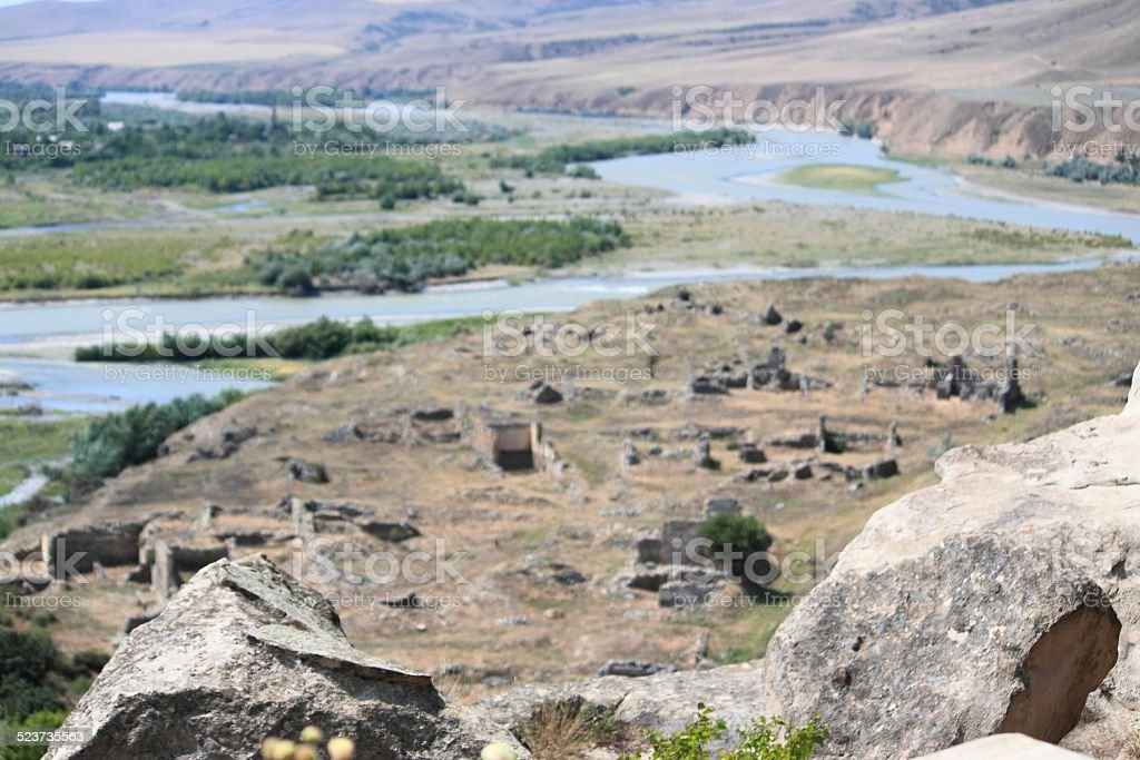 ruins and bend of river, view from cave ancient pagan stock photo