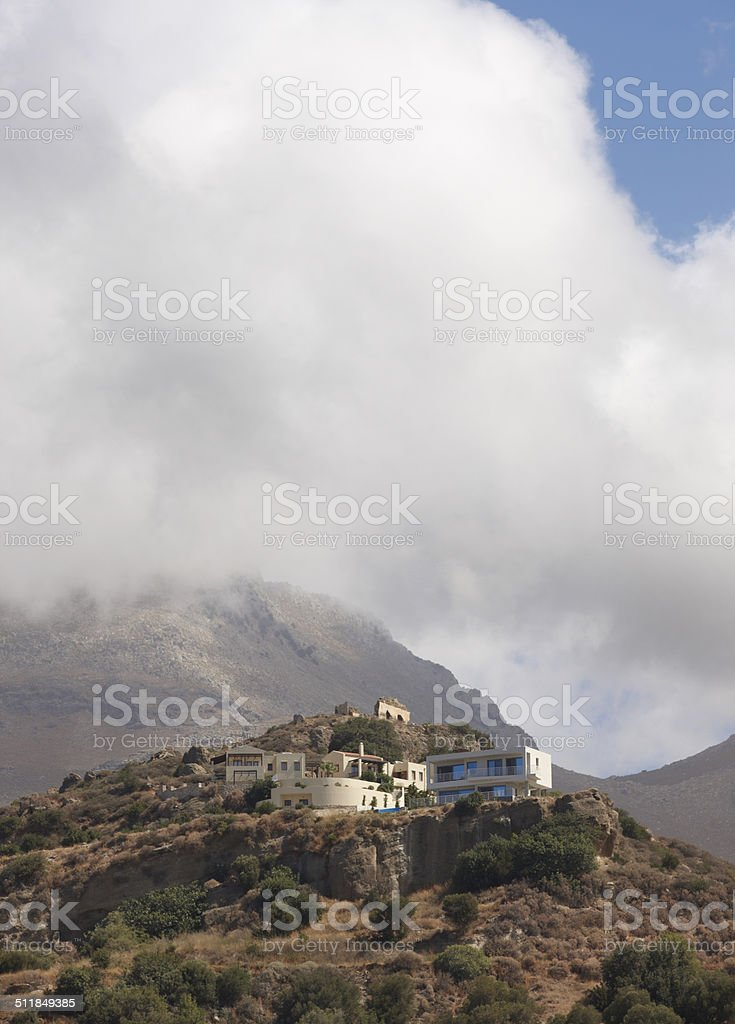 Ruins and modern houses in Crete. Greece stock photo