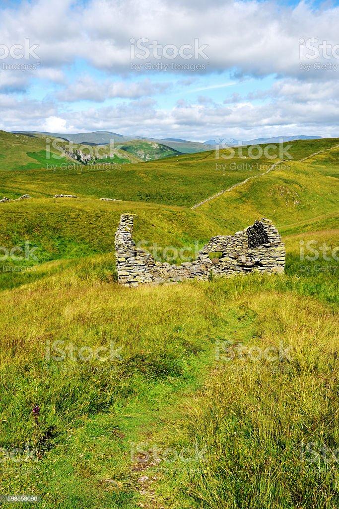Ruins of a farm building stock photo