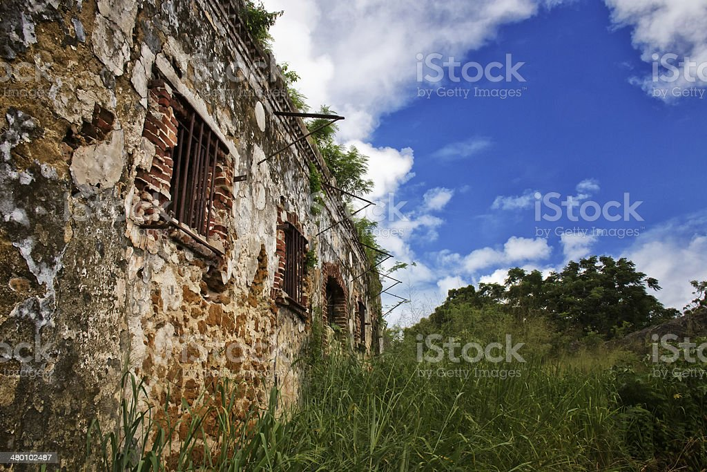 Ruins of a prison on a remote tropical island stock photo