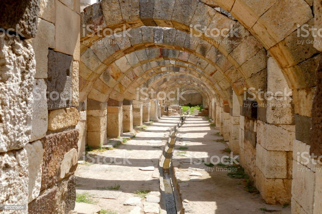 Ruins of agora in the city of Izmir. Ancient building with arches, built of stone. stock photo