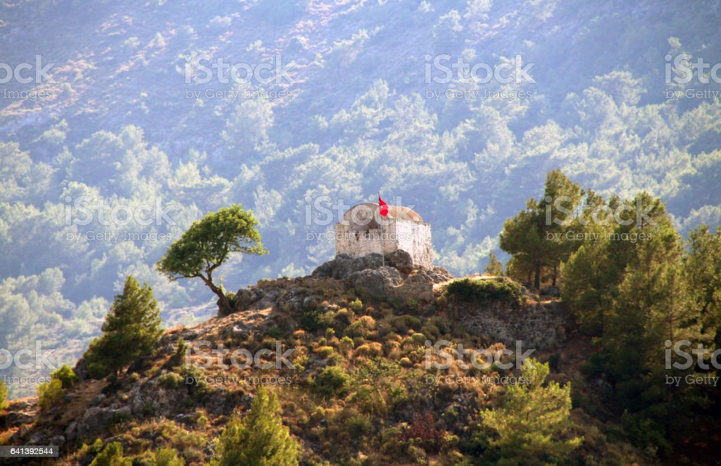 Ruins of ancient church on top of the hill in ghost town of Kayakoy (Turkey) stock photo