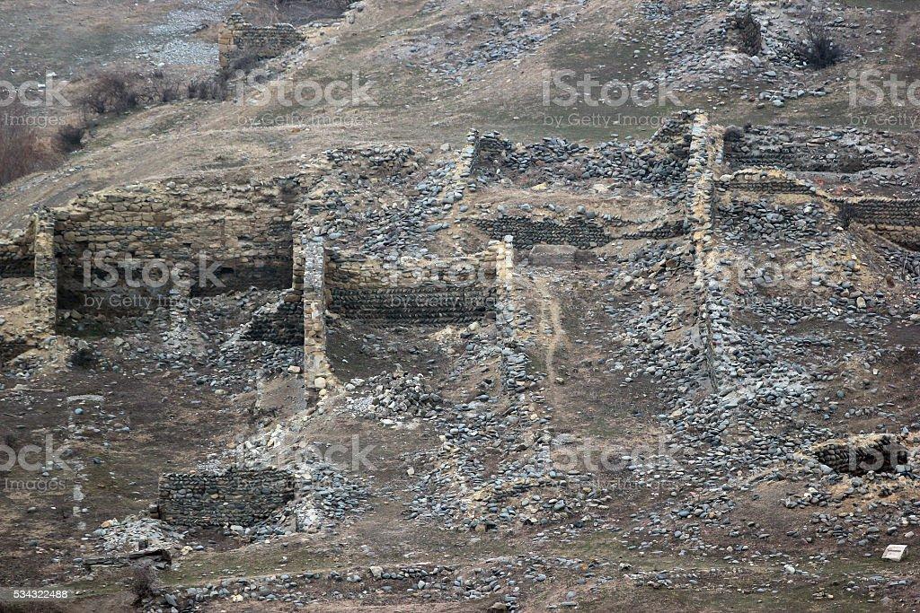 Ruins of ancient houses near cave pagan city Uplistsihe, Georgia stock photo