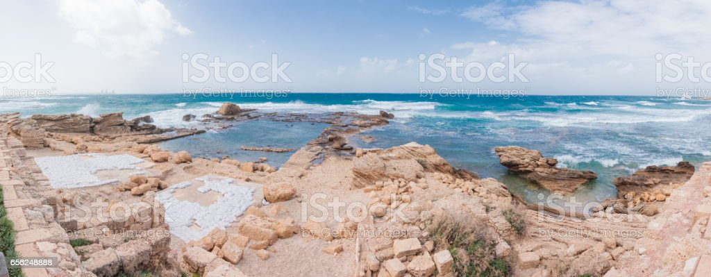 Ruins of commercial port in the old town of Caesarea stock photo