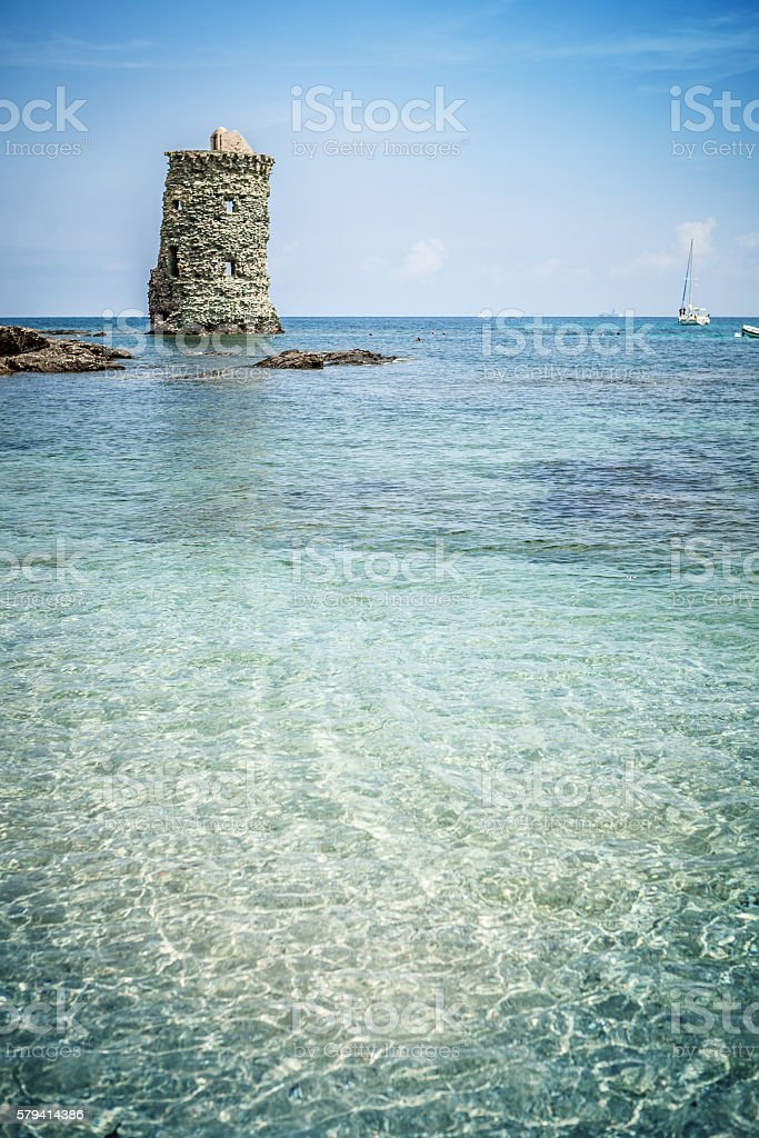 Ruins of genovese tower in Corsica: Le Sentier des Douaniers stock photo