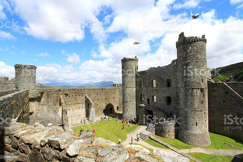 Ruins of Harlech Castle with Mount Snowdon in background stock photo