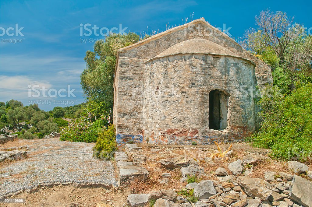 ruins of medieval church with green trees around stock photo