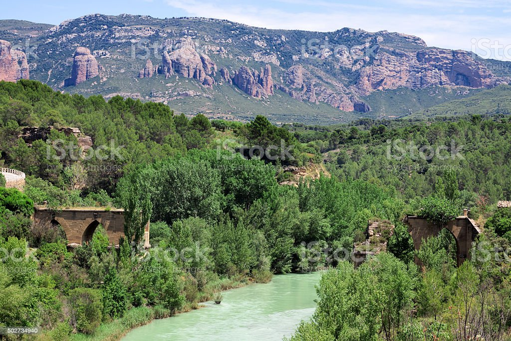 Ruins of old bridge over river Gallego. stock photo
