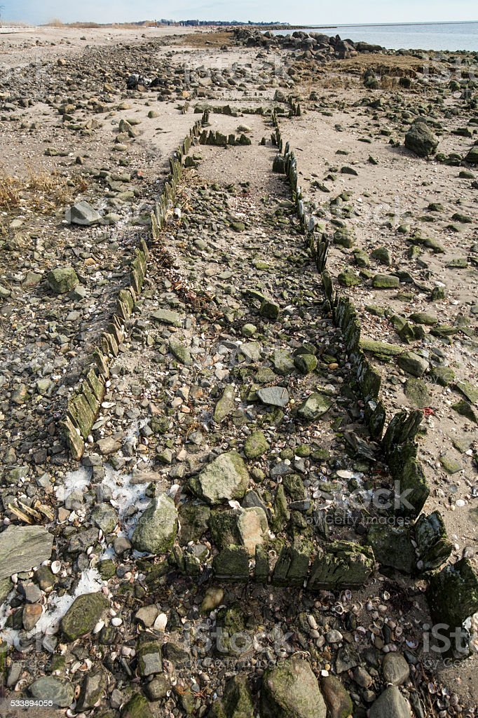 Ruins of old dock on beach at Silver Sands, Connecticut. stock photo