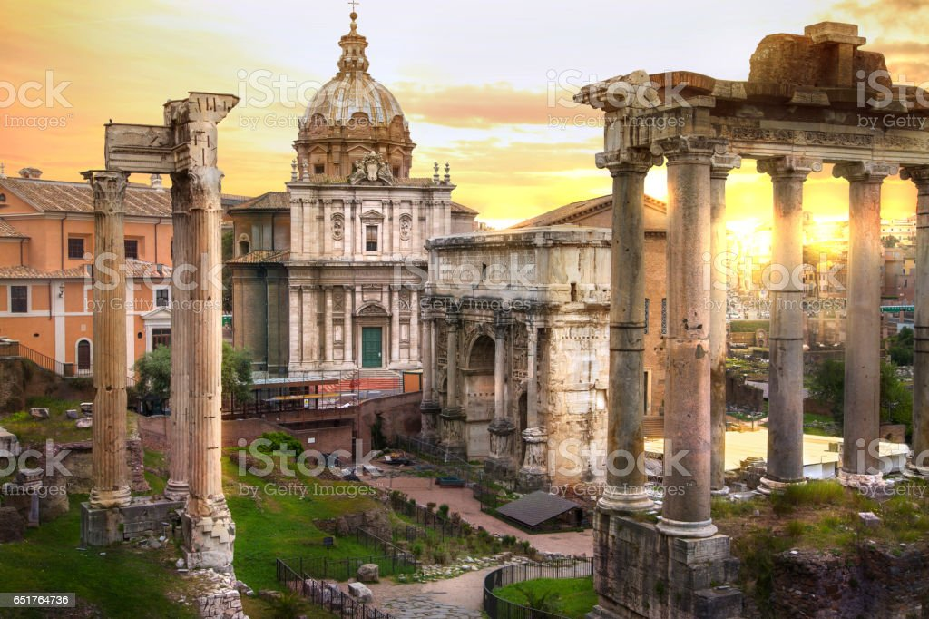 Ruins of Roman's forum at sunset, ancient government buildings started 7th century BC. Rome stock photo