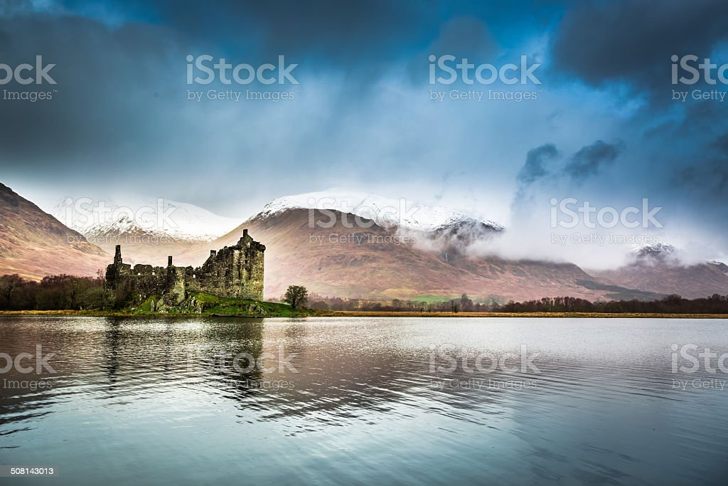 Ruins of the castle on the lake stock photo