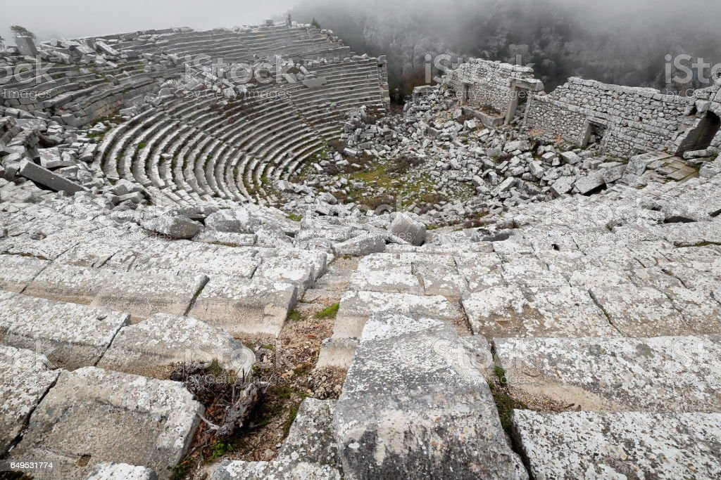 Ruins of the Hellenistic-Roman theater under the mist. Termessos-Turkey. 1948 stock photo