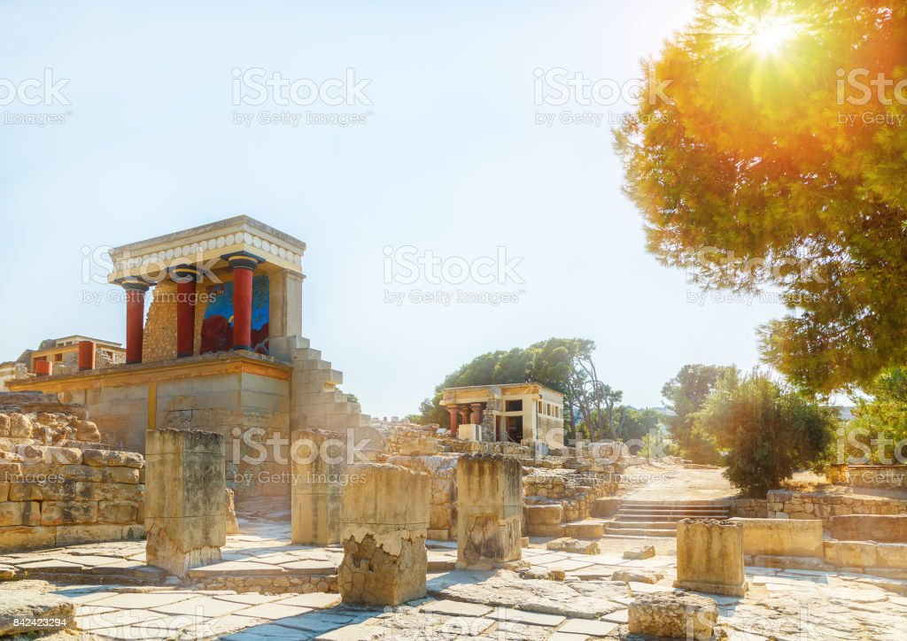Ruins of the Knossos Palace with the sun filtering through the trees at Crete, Greece stock photo
