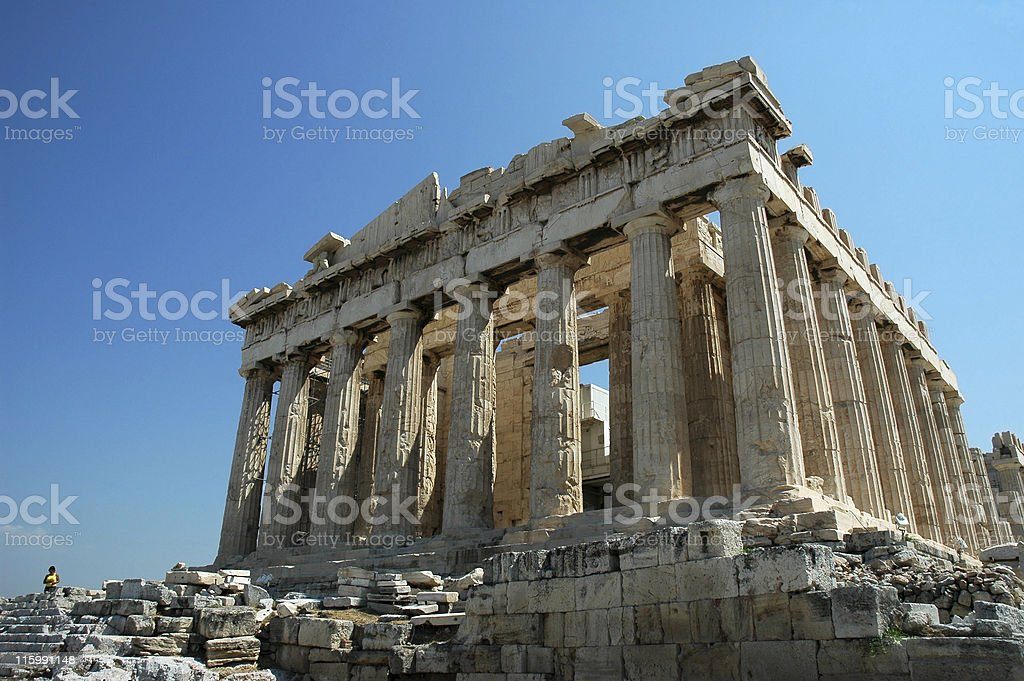 Ruins of the Parthenon in Greece against a blue sky stock photo