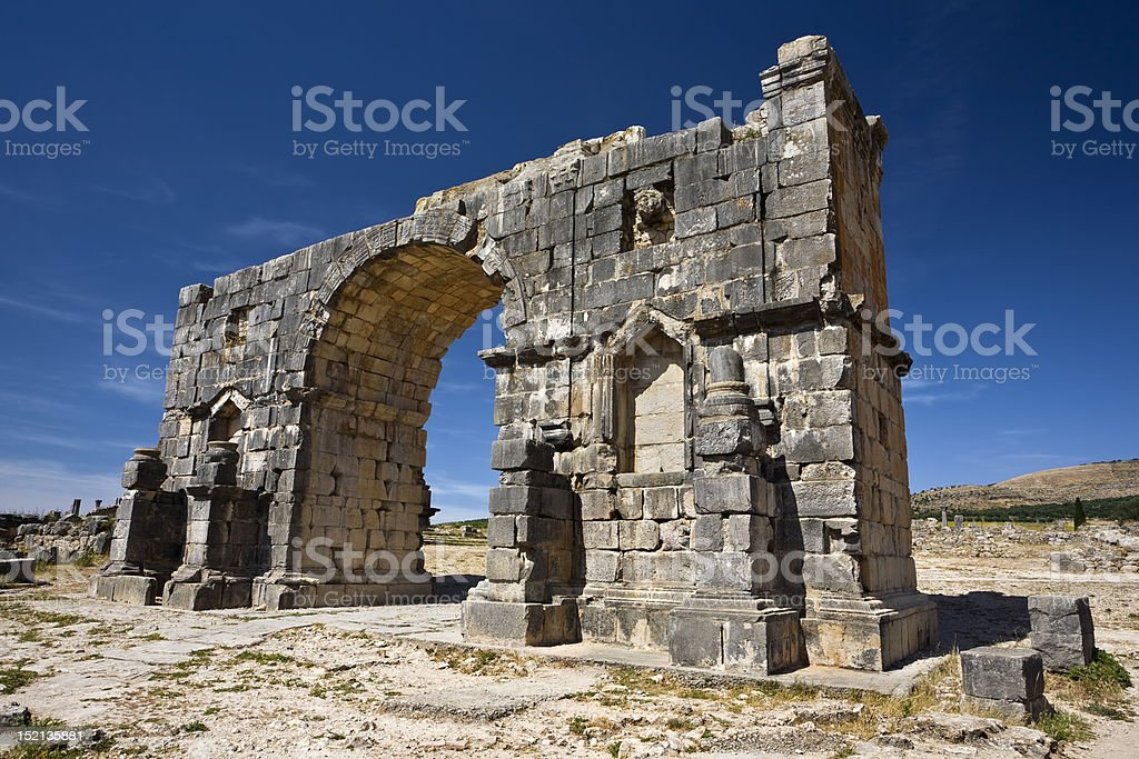 Ruins of the triumphal arch in Volubilis stock photo