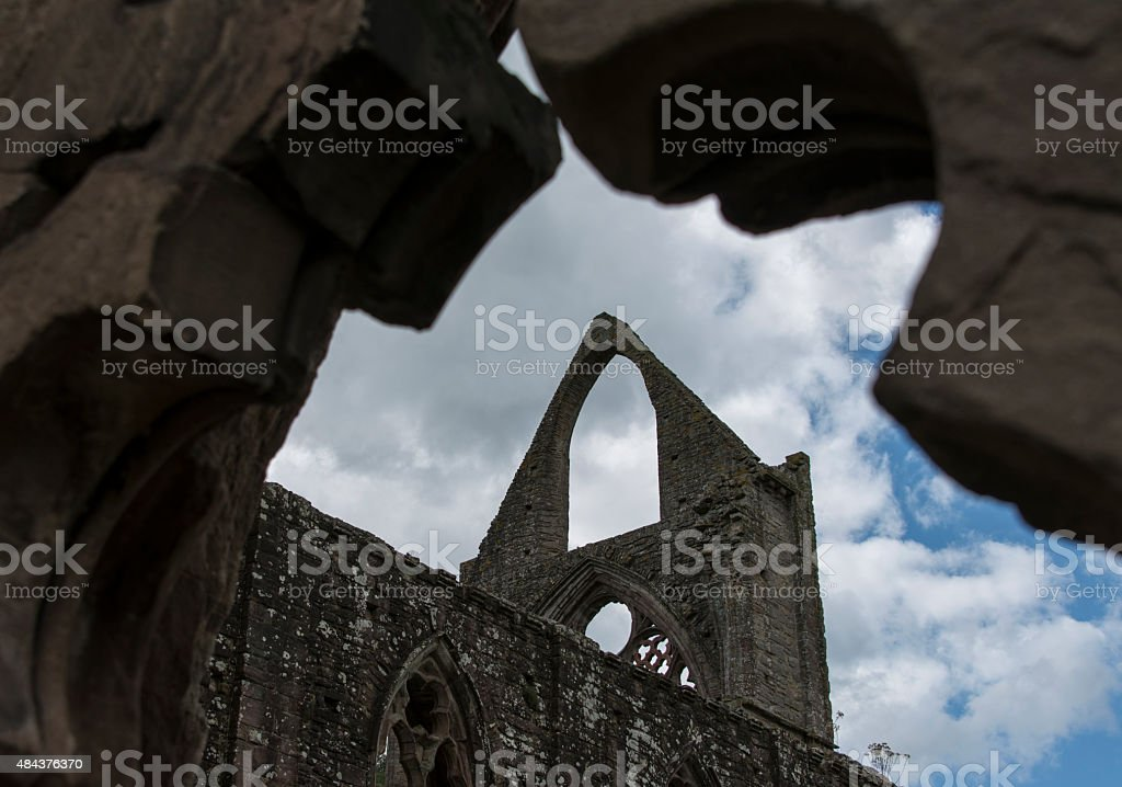 Ruins of Tintern Abbey Against Cloudy Blue Sky stock photo