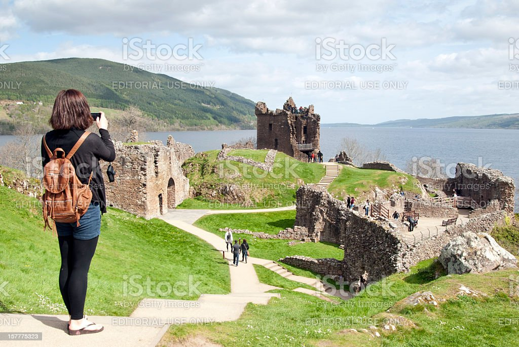 Ruins of Urquhart Castle which sits on the Loch Ness stock photo