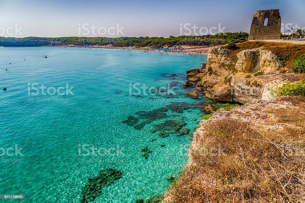 Ruins of watchtower on cove on the coast of Puglia stock photo