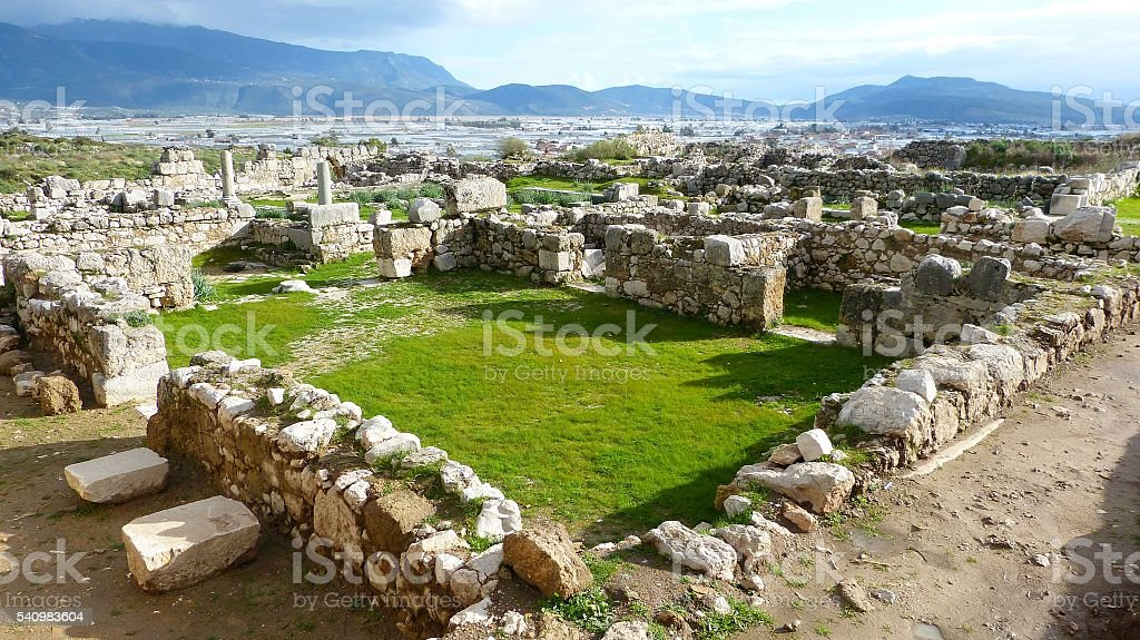 Ruins of Xanthos in Turkey with Kinik township in the background. stock photo