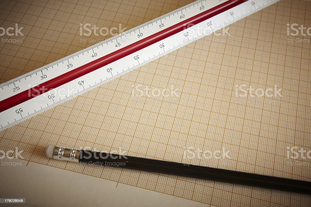 Ruler and pencil with graph paper royalty-free stock photo