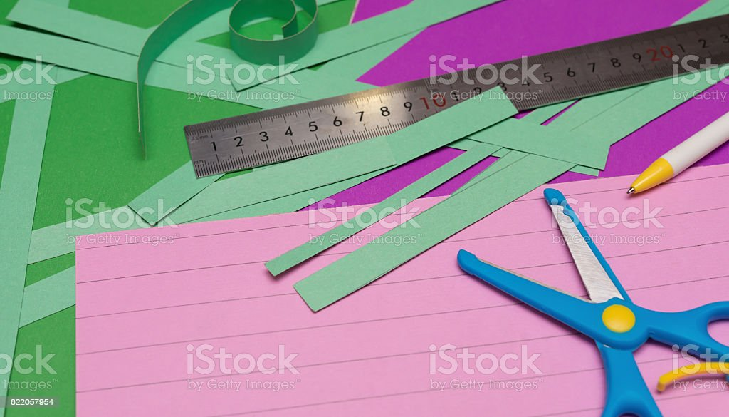 ruler and scissors and hand cut paper straps stock photo