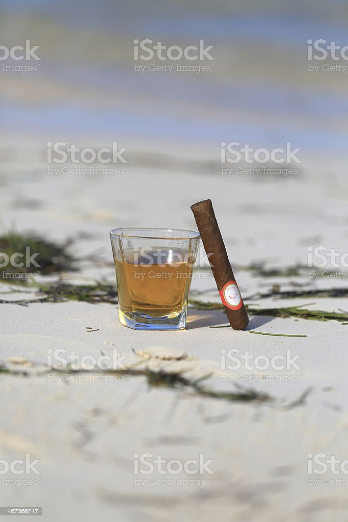 Rum and cigar at the beach stock photo