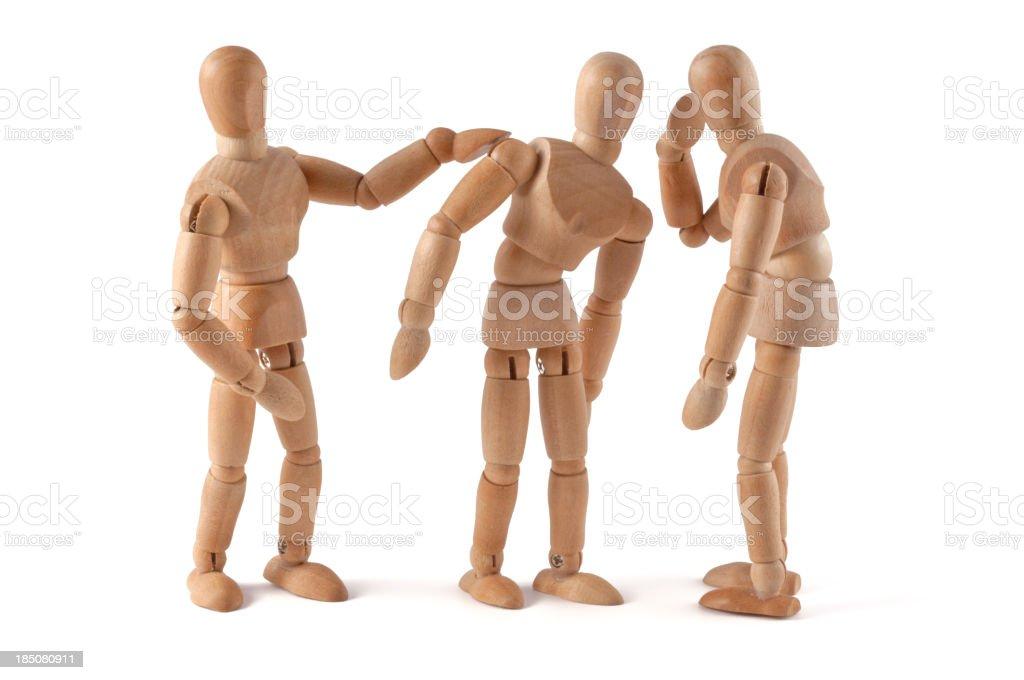 Rumors - wooden mannequin wispering stock photo