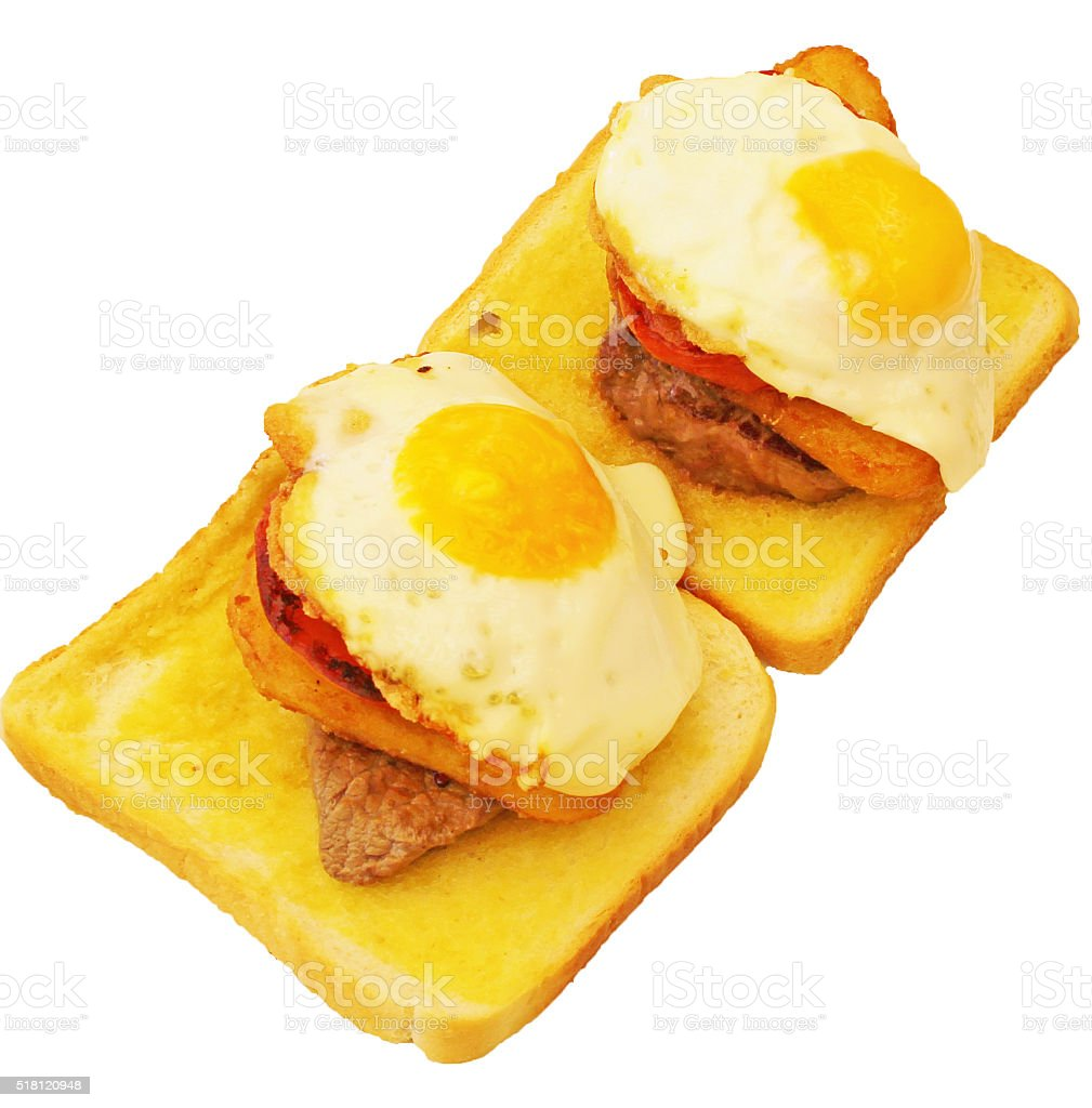Rump steak, bacon and egg on toast. stock photo