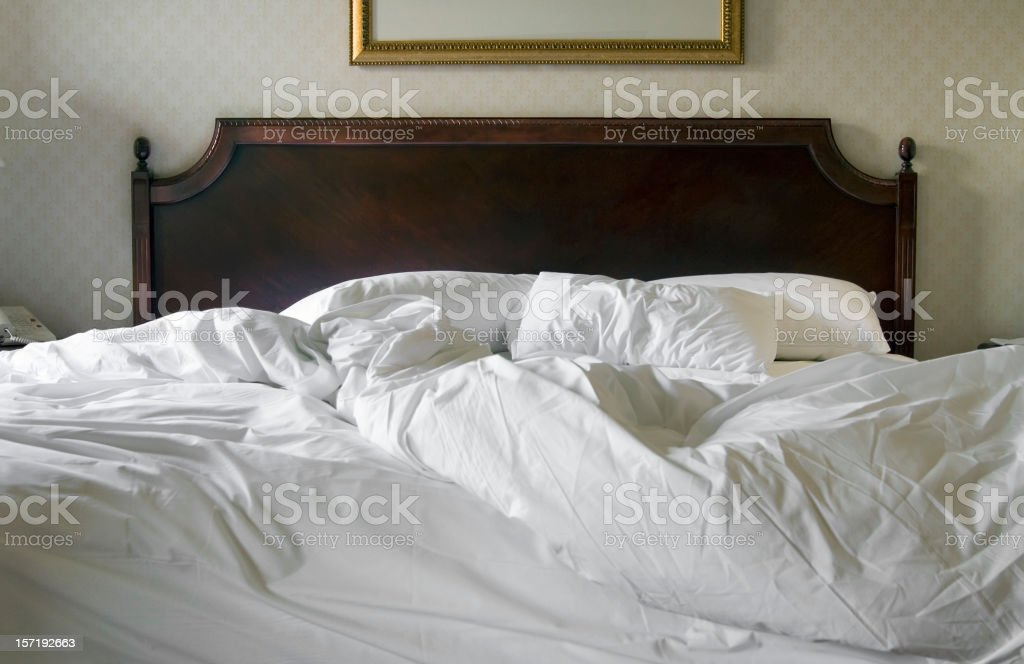Rumpled bed stock photo
