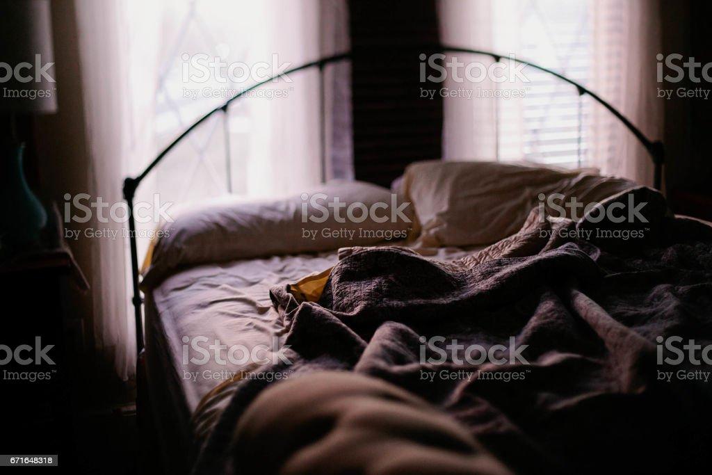 rumpled bedsheets stock photo