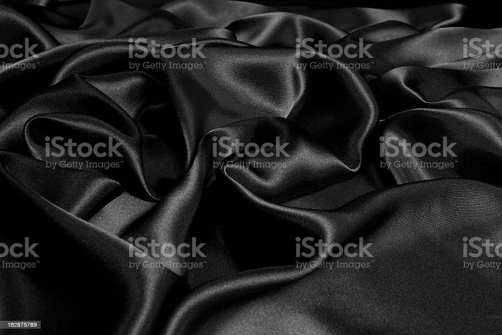 Rumpled black satin background stock photo