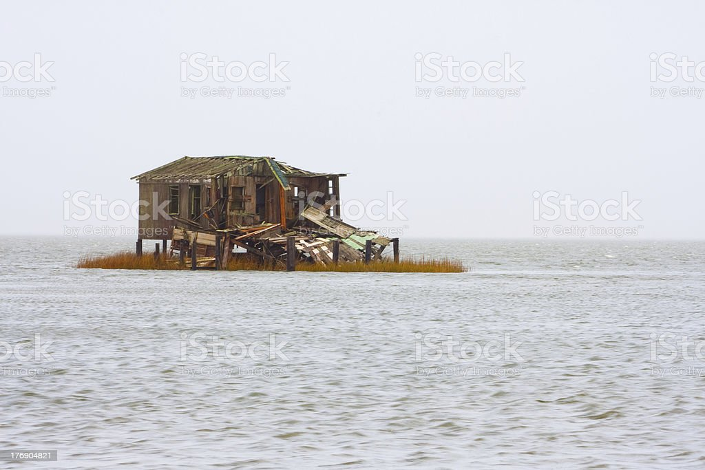Run down shack on stilts royalty-free stock photo