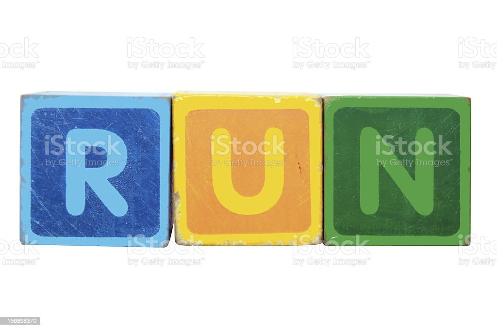 run in toy block letters royalty-free stock photo