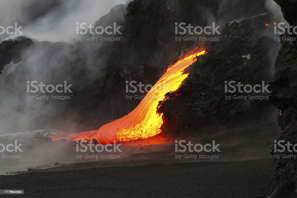 A run of lava flow at night downhill royalty-free stock photo