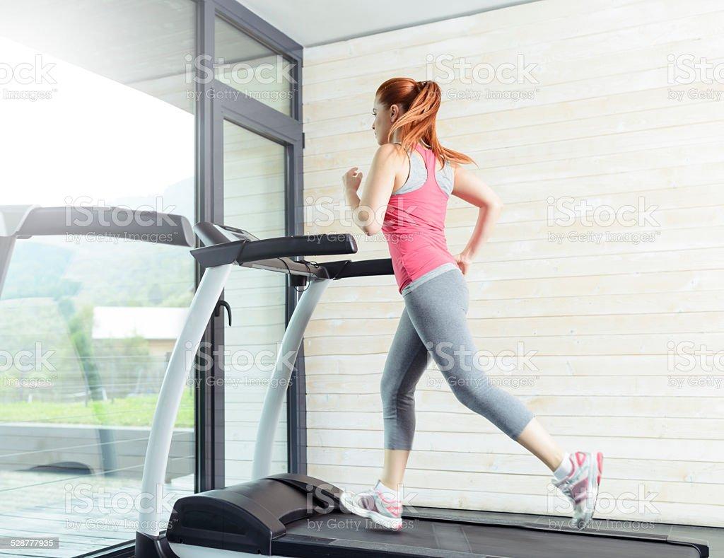 run on treadmill stock photo