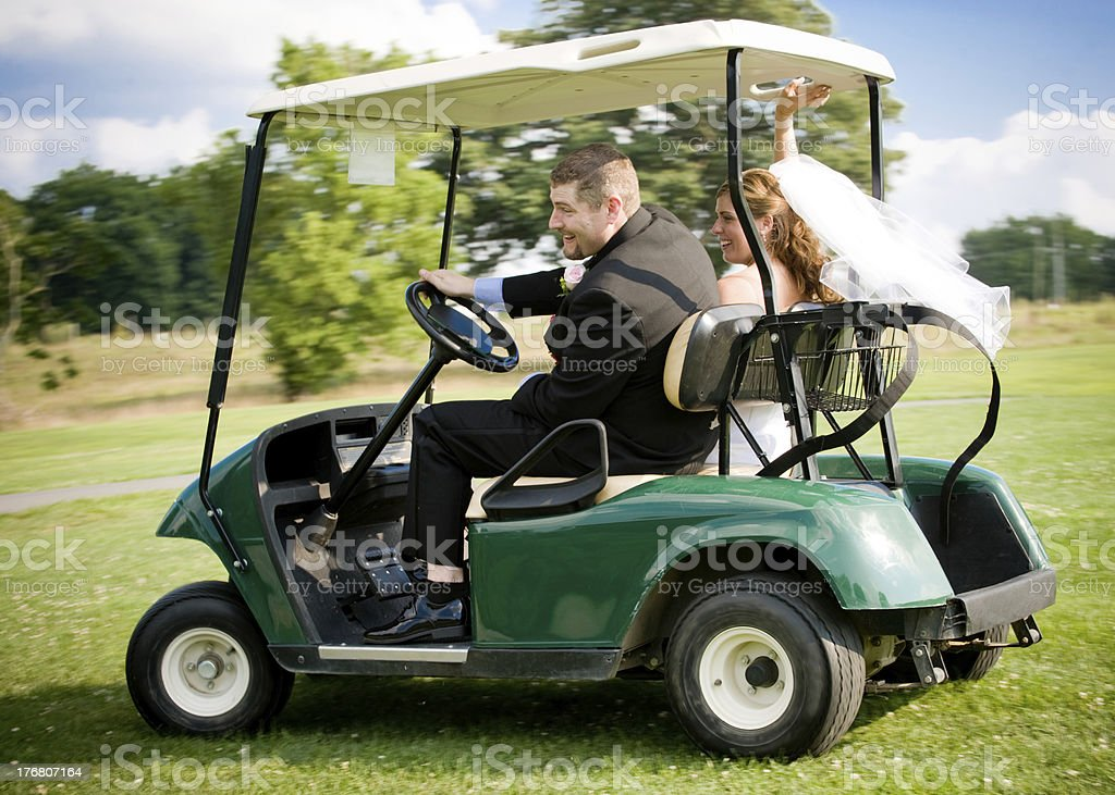 Runaway Bride and Groom... On Golfcart! stock photo