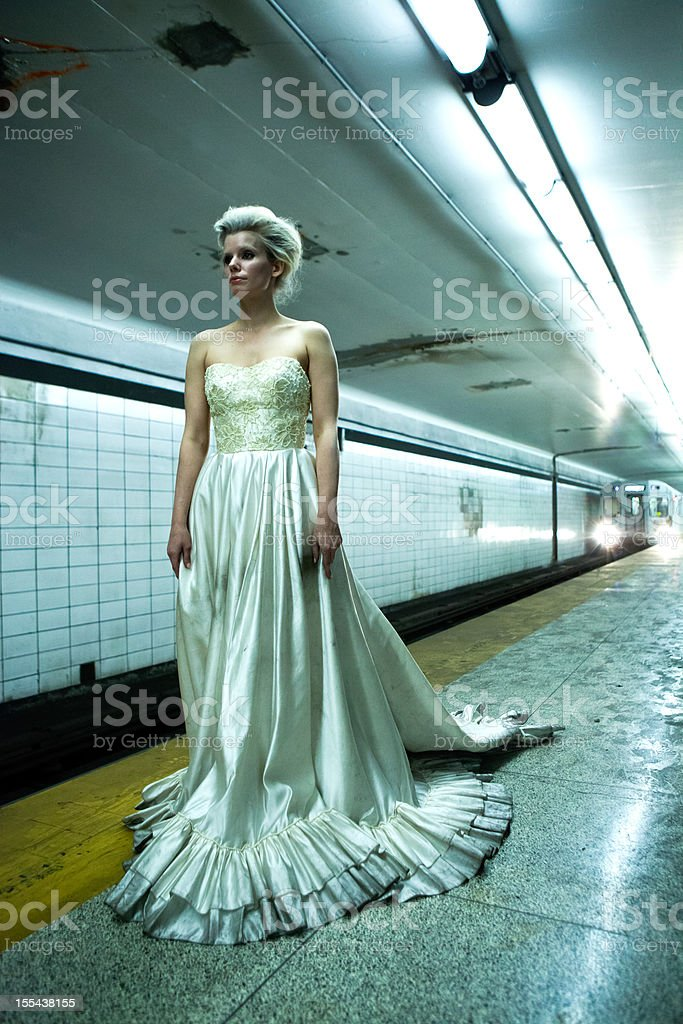 Runaway bride in a subway station stock photo