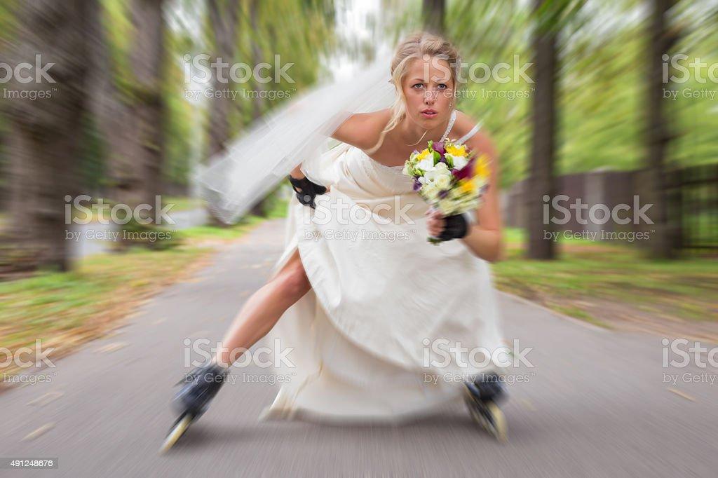 Runaway bride on roller skates stock photo