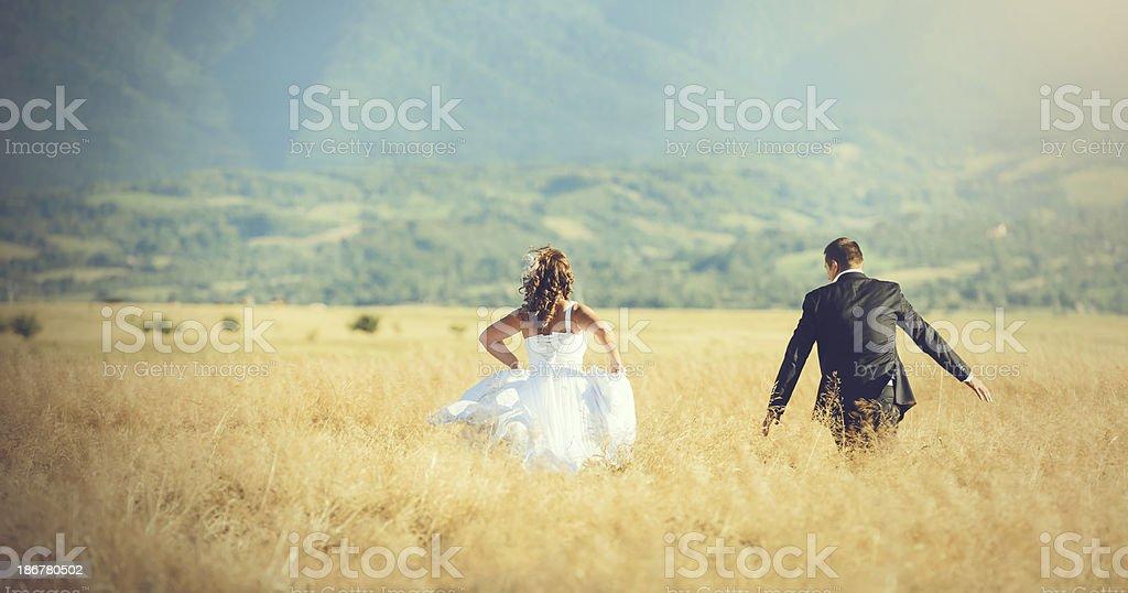 runaway couple royalty-free stock photo