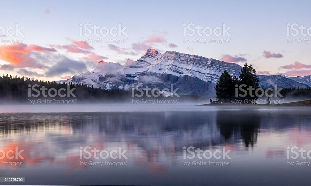 Rundle Mountain reflecting in Two Jack Lake stock photo